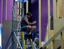 "Construction on the set of ""Rumors""."